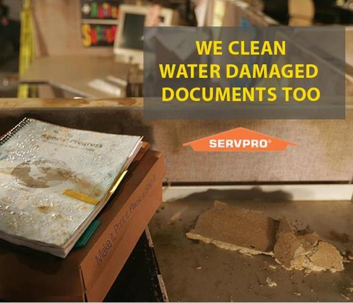 water damaged documents on box on desk, in office cube, wet tile, SERVPRO logo words we clean water damaged documents too