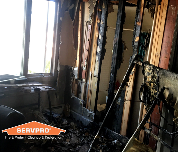 fire damage in a home with SERVPRO logo
