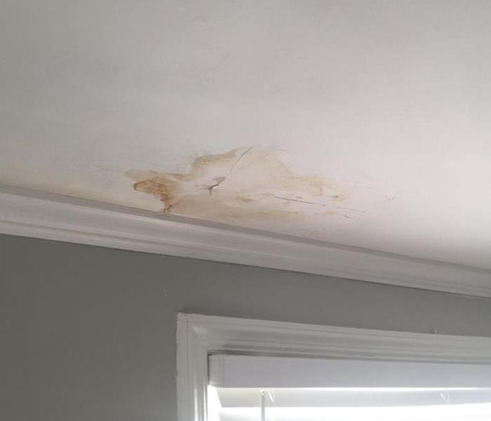 discoloration on a white ceiling from water damage
