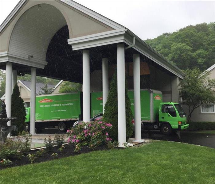 servpro trucks in front of commercial fire damage loss