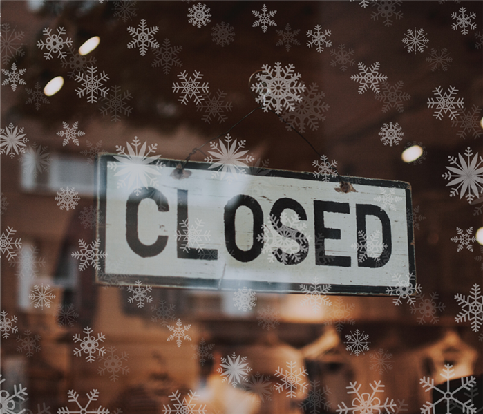 closed sign with snowflakes