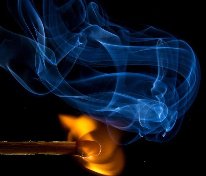 match ignites with smoke and fire on a black background