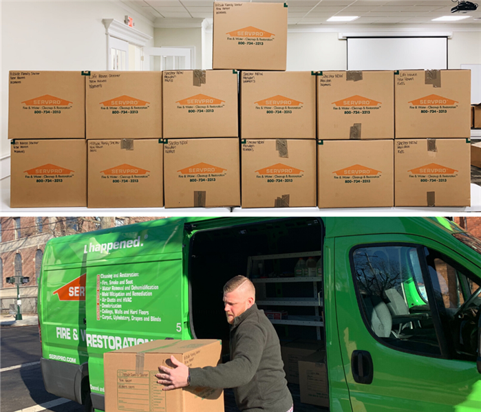 servpro boxes full of donations, servpro marketer unloading donation boxes from servpro van